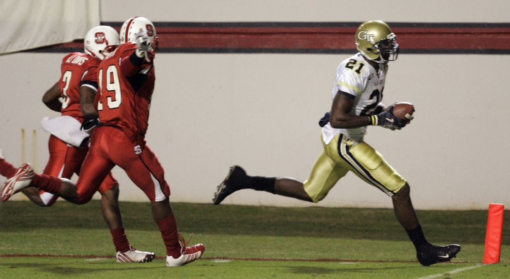 North Carolina State's A.J. Davis arland Heath chase Calvin Johnson as he scores during the first half.