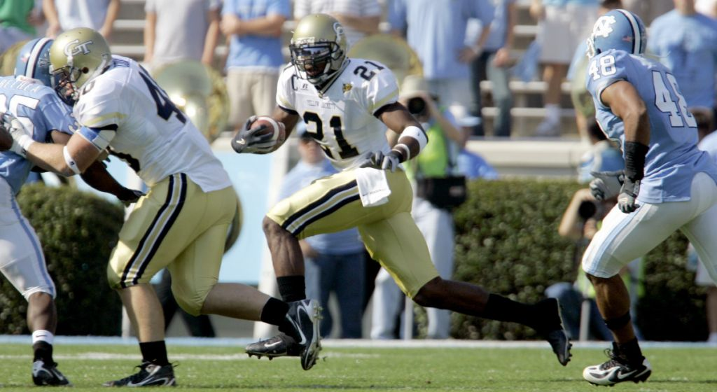 Georgia Tech's Calvin Johnson (21) gets a block from Mike Cox, left, as North Carolina's Durell Mapp (48) chases during the first half of a college football game in Chapel Hill, N.C., Saturday, Nov. 11, 2006. (AP Photo/Gerry Broome)