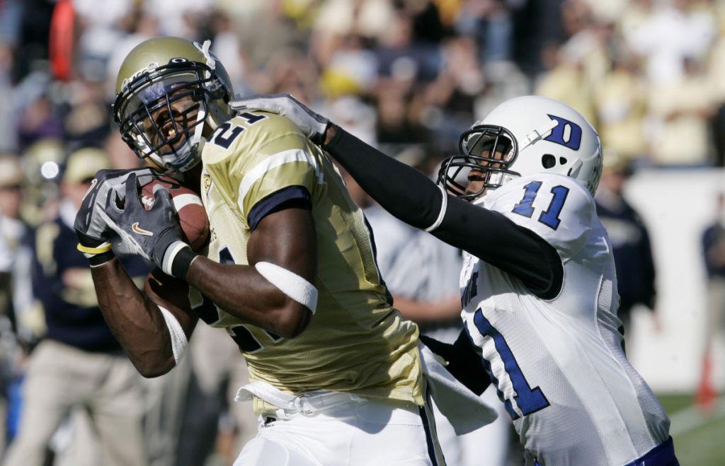 Georgia Tech's Calvin Johnson (21) makes a catch for a first down as Duke's John Talley (11) defends in the first quarter of an ACC college football game in Atlanta, Saturday, Nov. 18, 2006. (AP Photo/John Bazemore)