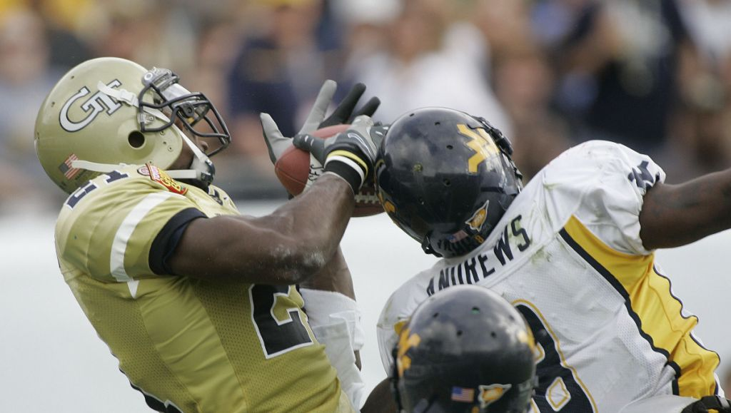 Georgia Tech receiver Calvin Johnson, left, makes a second-quarter touchdown catch despite the defensive efforts of West Virginia's Quinton Andrews, during the Gator Bowl football game, Monday, Jan. 1, 2007, in Jacksonville, Fla. (AP Photo/Phil Coale)