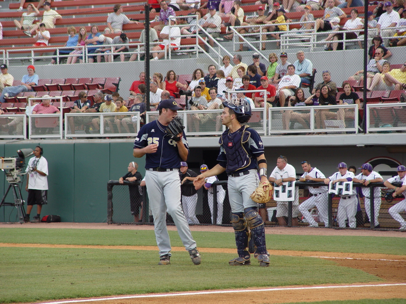Deck McGuire and Jason Haniger meet during a Bison rally in the second inning of Tech's NCAA regional game vs. Lipscomb, May 31, 2008.