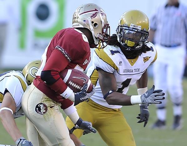 Morgan Burnett (1) tracks down FSU player Jermaine Thomas. Photo by LensEffects