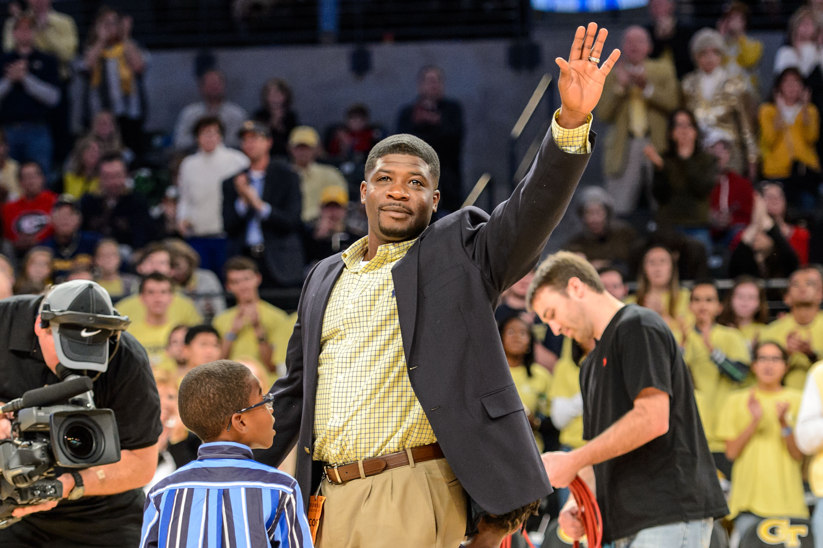 Former Georgia Tech quarterback Joe Hamilton is recognized on the court for his upcoming induction into the College Football Hall of Fame