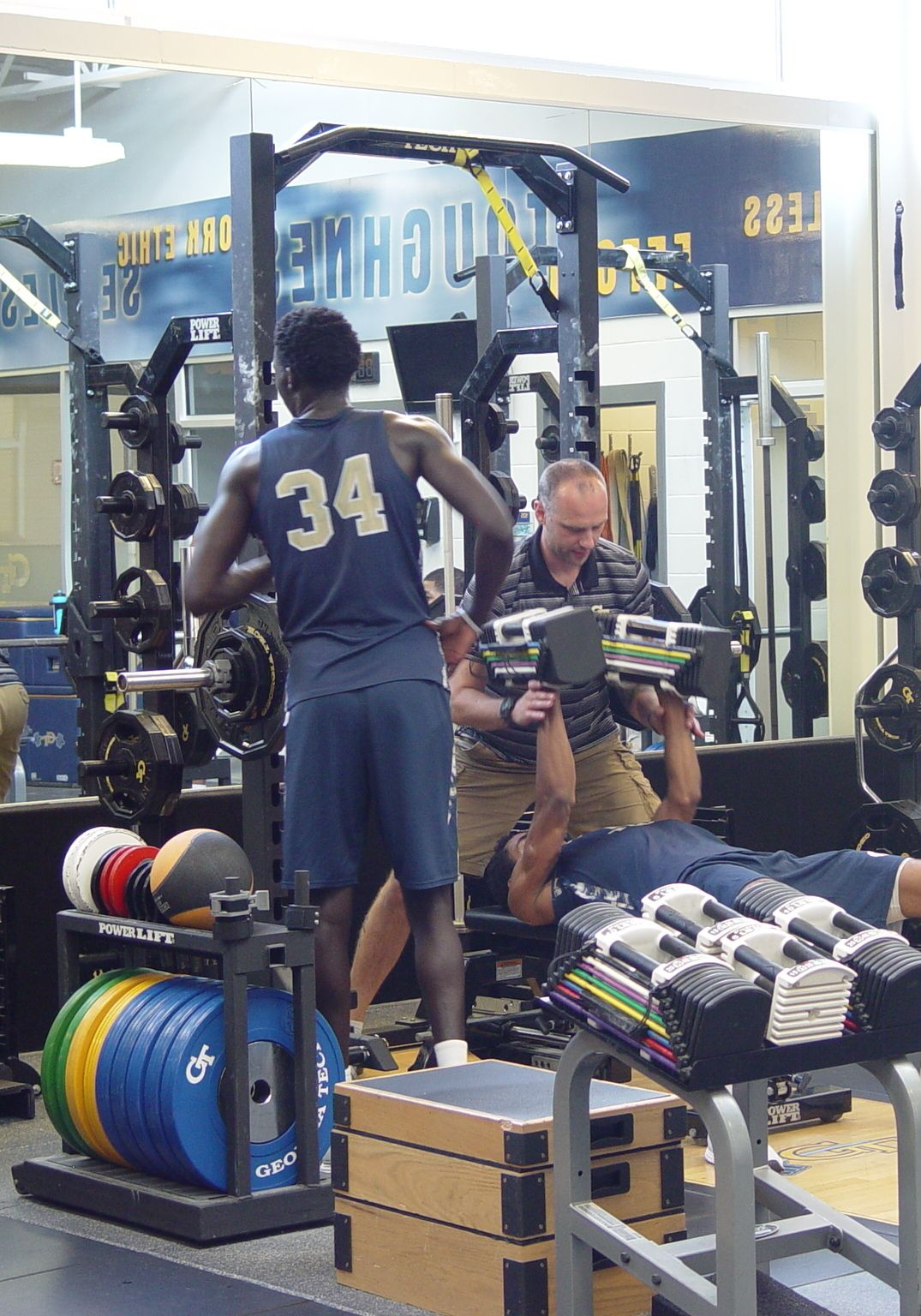 Player development coach Dan Taylor takes the Georgia Tech men's basketball team through a workout on June 16, 2016 in the Zelnak Center weight room.
