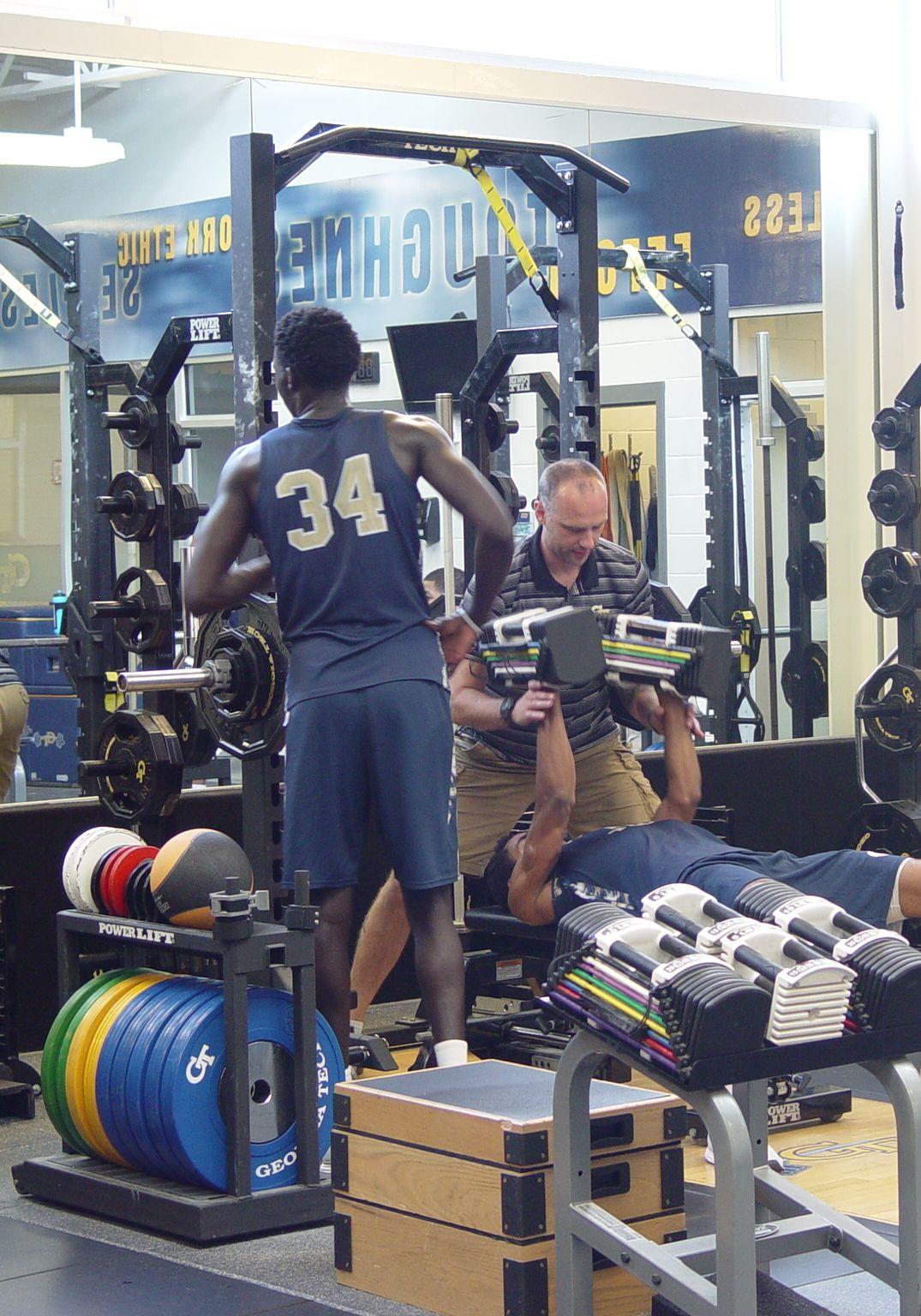 Player development coach Dan Taylor takes the Georgia Tech men's basketball team through a workout on June 16, 2016 in the Zelnak Center weight room.