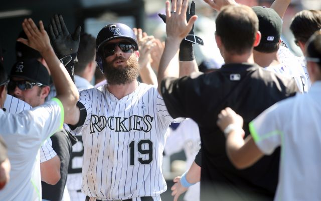 Jun 21, 2015; Denver, CO, USA; Colorado Rockies center fielder Charlie Blackmon (19) celebrates with teammates in the dugout after scoring during the sixth inning against the Milwaukee Brewers at Coors Field. Credit: Chris Humphreys-USA TODAY Sports