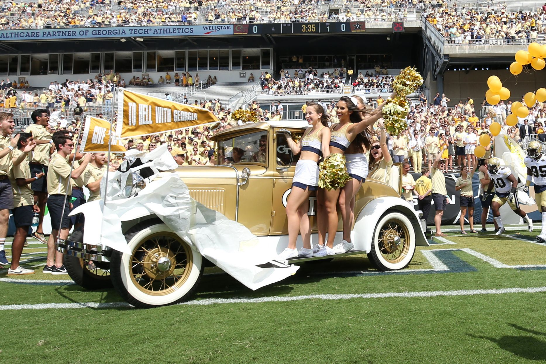 The Georgia Tech Yellow Jackets Ramblin' Wreck drives onto the field before the Jackets' game against the Vanderbilt Commodores at Bobby Dodd Stadium. Jason Getz-USA TODAY Sports