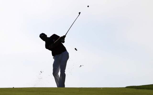Oct 1, 2016; Chaska, MN, USA; Matt Kuchar of the United States plays his shot from the fairway on the tenth hole during the morning foursome matches in the 41st Ryder Cup at Hazeltine National Golf Club. Mandatory Credit: Rob Schumacher-USA TODAY Sports