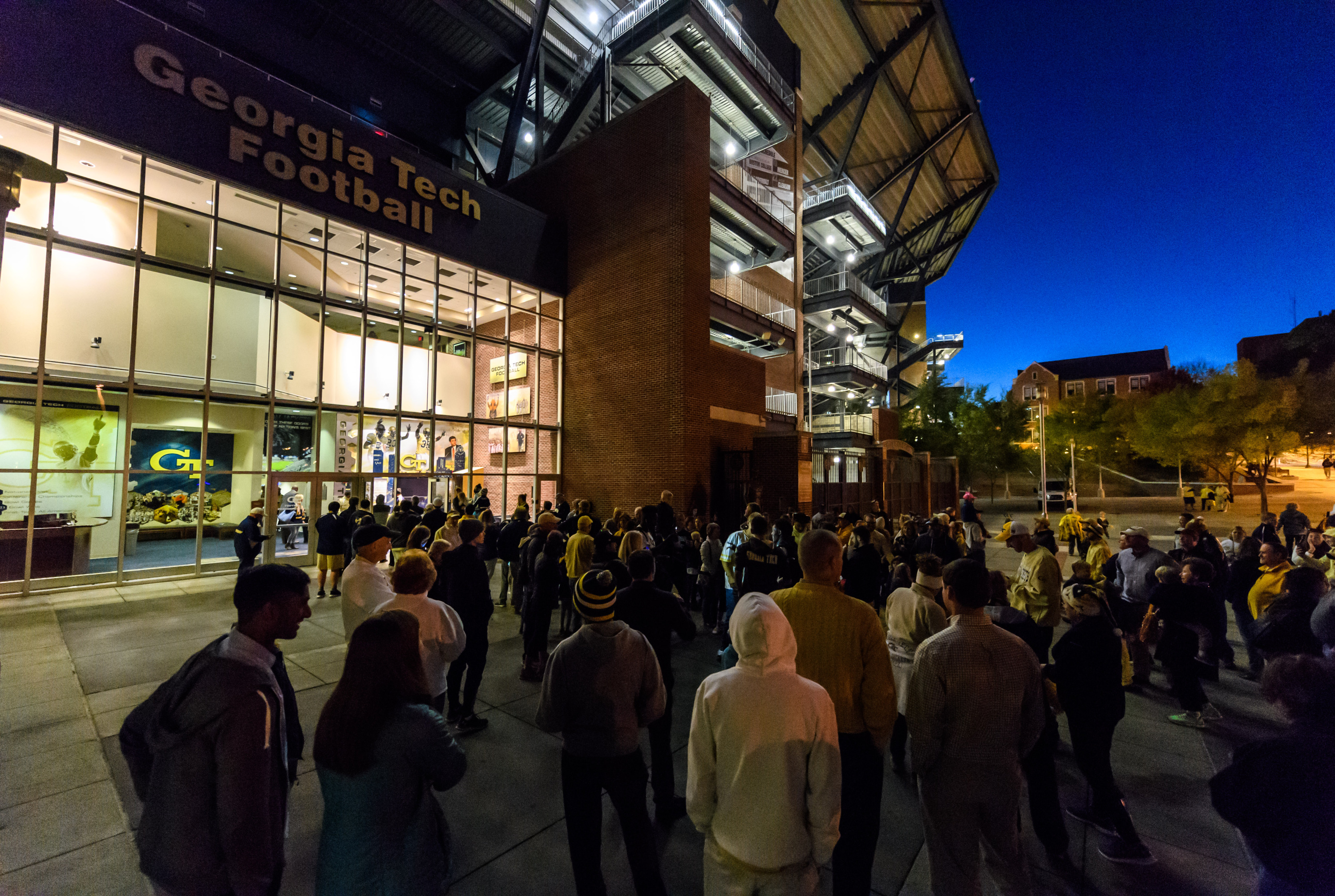 A crowd of fans awaited the team back at Bobby Dodd Stadium