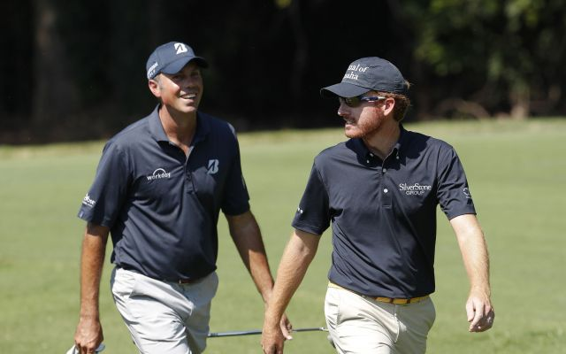 Former Georgia Tech golfers, Matt Kuchar, left, and Roberto Castro chat as they walk to the second green during the final round of play at the Tour Championship golf tournament at East Lake Golf Club Sunday, Sept. 25, 2016, in Atlanta. (AP Photo/John Bazemore)