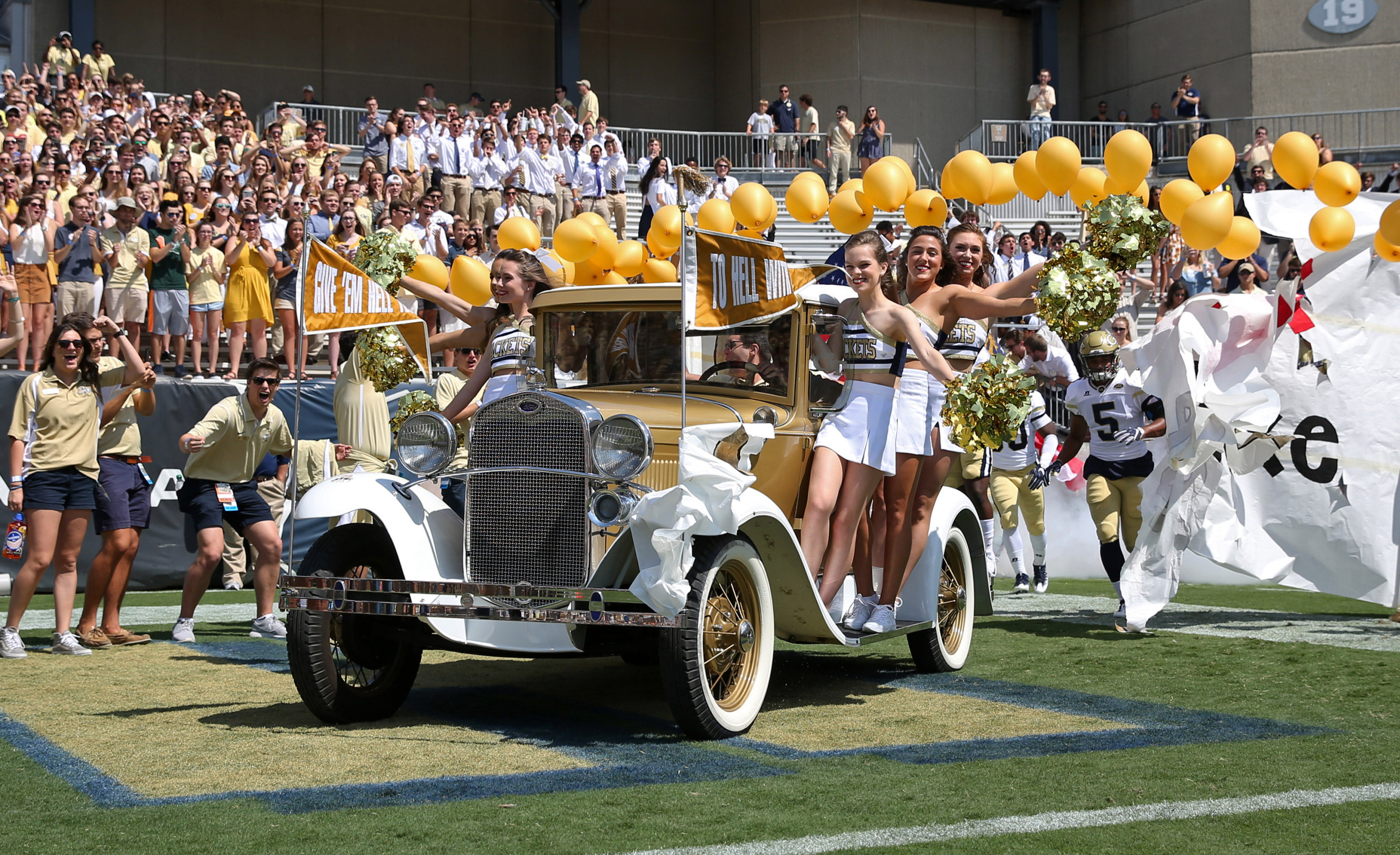 Yellow Jackets cheerleaders ride on the Ramblin Wreck before a game against the Jacksonville State Gamecocks at Bobby Dodd Stadium. Jason Getz-USA TODAY Sports