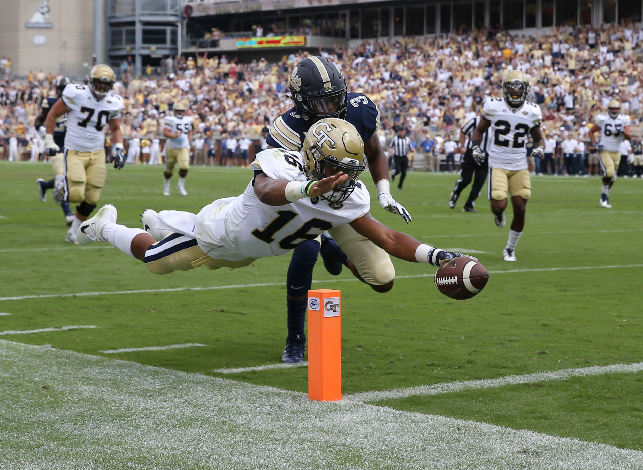 Yellow Jackets quarterback TaQuon Marshall (16) dives for a 32-yard touchdown against Pittsburgh Panthers. Jason Getz-USA TODAY Sports
