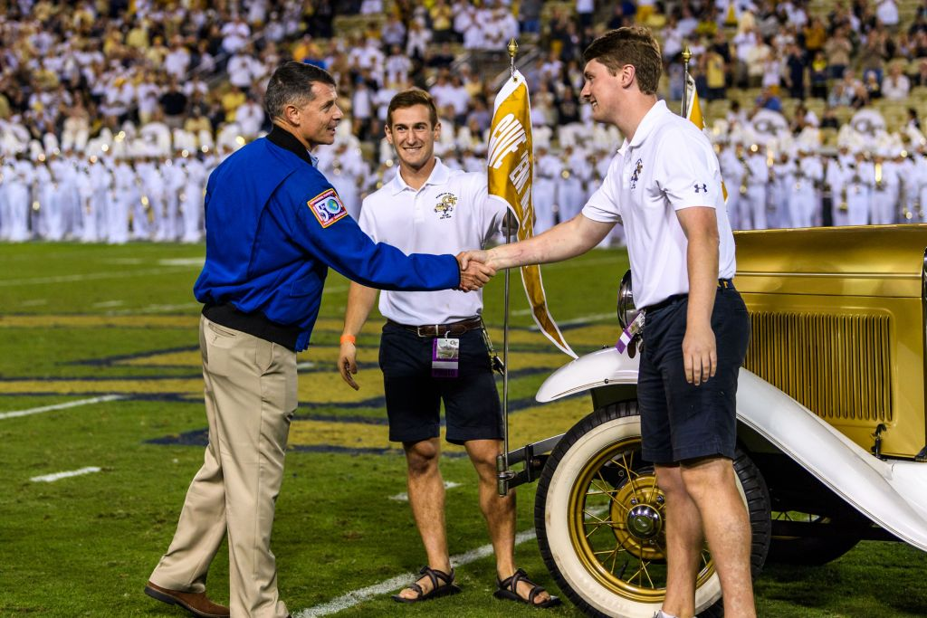Georgia Tech Alumni and NASA Astronaut Shane Kimbrough returns a flag from the Ramblin' Reck that was brought to the International Space Station
