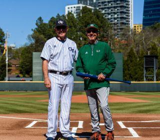 Coach  Danny  Hall (17) presents a bat to Miami Coach Jim Morris