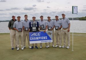 Georgia Tech holds their trophies after winning the the 2018 ACC Men's Golf Championship in New London, N.C., Sunday April 22, 2018. from left - head coach Bruce Heppler, Noah Norton, Luke Schniederjans, Jacob Joiner, Chris Petefish, Tyler Strafaci, Andy Ogletree, assistant coach Drew McGee.(Photo by Nell Redmond, theACC.com)