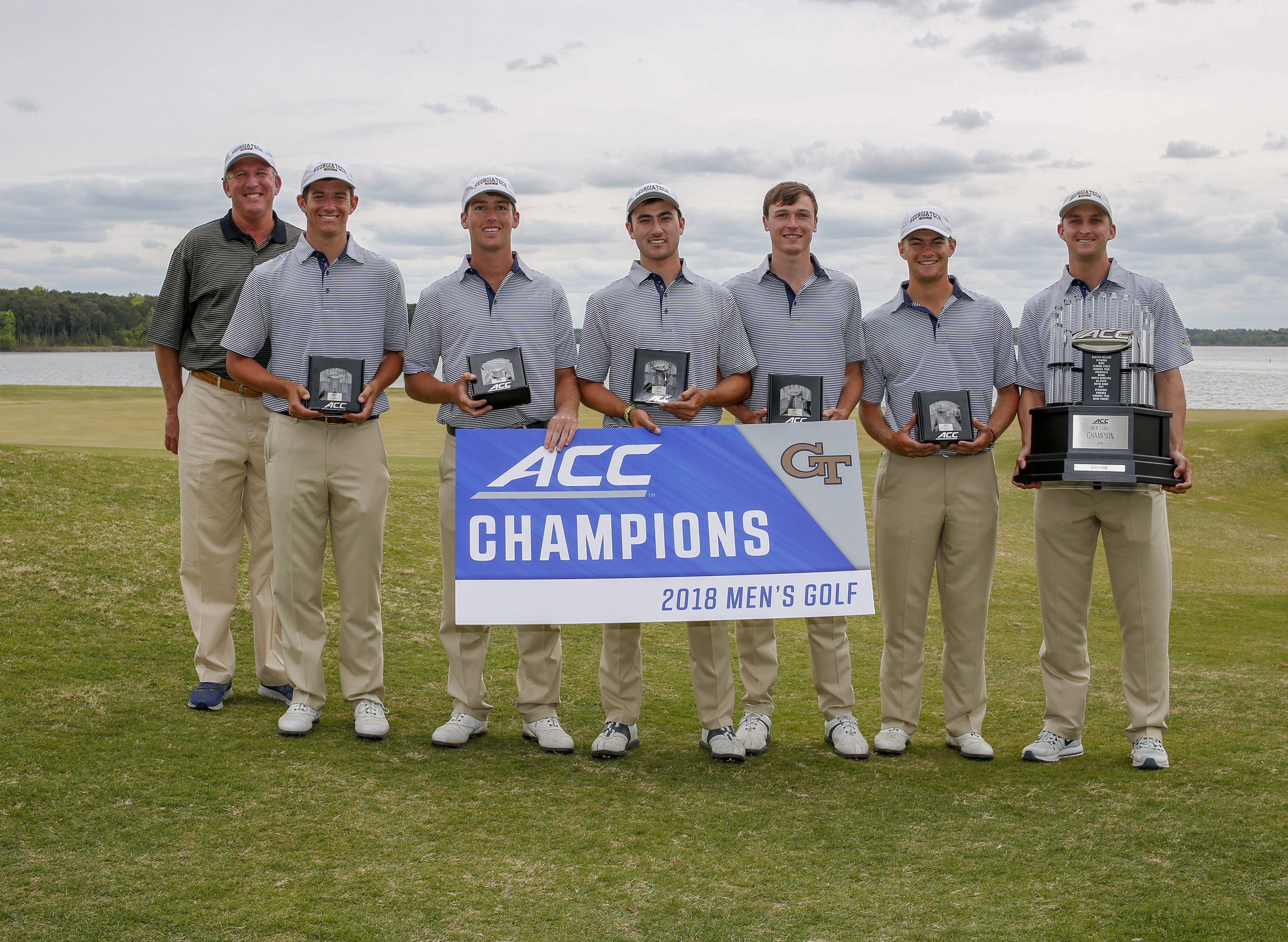 Georgia Tech holds their trophies after winning the the 2018 ACC Men's Golf Championship in New London, N.C., Sunday April 22, 2018. From left: head coach Bruce Heppler, Noah Norton, Andy Ogletree, Chris Petefish, Luke Schniederjans, Tyler Strafaci, assistant coach Drew McGee. (Photo by Nell Redmond, theACC.com)