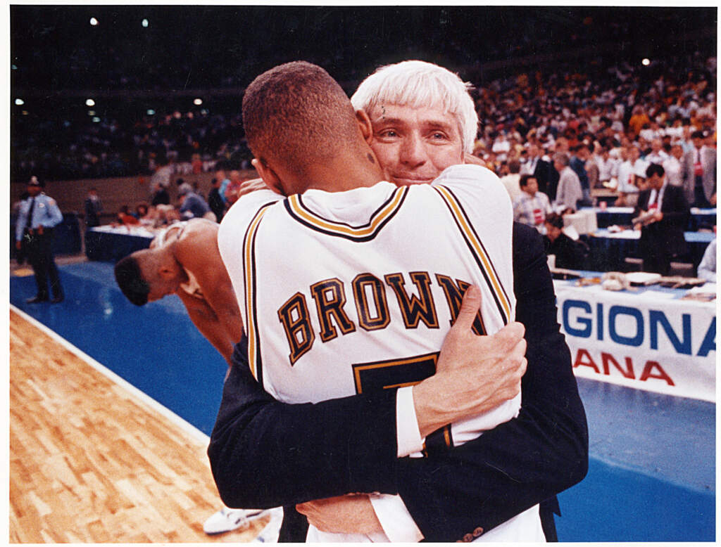 Head coach Bobby Cremins and Karl Brown embrace following Tech's victory over Minnesota in the 1990 NCAA Southeast Regional championship game.